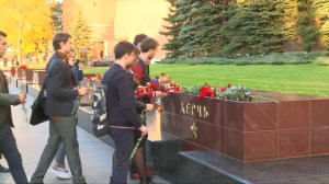 Flowers, candles laid at makeshift memorial for victims of Crimea college attack