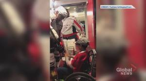 Alexander Ovechkin gives hockey stick to young fan in wheelchair following game in Calgary