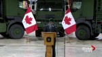 Federal defence minister visits CFB Gagetown to see new logistics trucks
