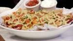 Gary Cork showcases one of the Tir Nan Og's most popular dishes, Buffalo Chicken Nachos