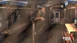 Bystanders held up phones as woman raped on Philadelphia train, police say (01:35)