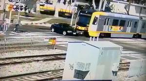 Driver survives with only 'scrapes and bruises' after being run over by train at level crossing