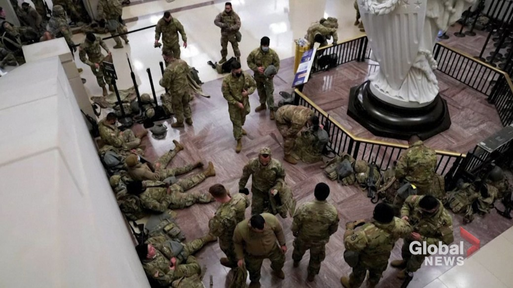 Click to play video 'National Guard troops fill U.S. Capitol during Donald Trump impeachment debate'