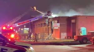 Kingston Fire and Rescue douse hot spots at a fire Wednesday morning (01:13)