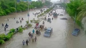 Monsoon rains flood Pakistan's financial capital, forcing residents to abandon homes