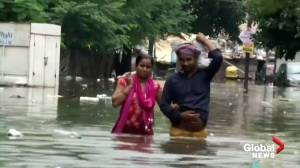 Flood waters swamp India after late monsoon rains