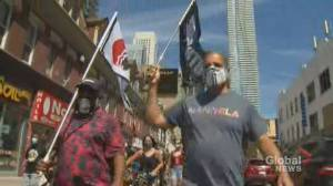 Protesters march in Toronto to commemorate Emancipation Day