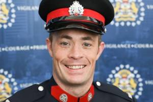 Police escort Tuesday for Calgary officer killed in the line of duty (02:05)