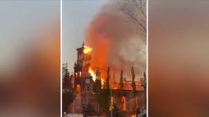 Flames engulf Catholic church in Morinville (02:10)