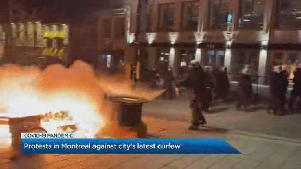 Click to play video: 'Hundreds defy curfew in Montreal in destructive protest of COVID-19 measures'