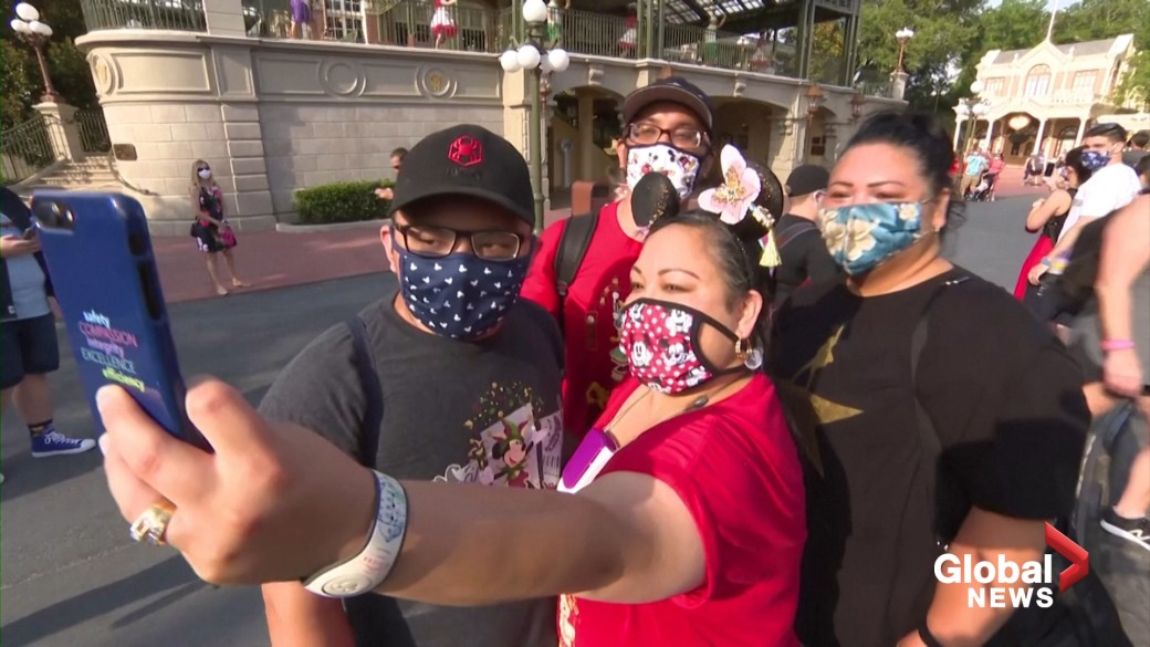 Click to play video 'Coronavirus: Masked guests enter Disney World in Florida for first time in months'