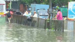 Mumbai floods: Residents wade through flooded streets after heavy rainfall (03:36)
