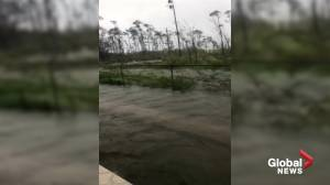 Water levels rise in Bahamas home as residents try to escape waist-high floods