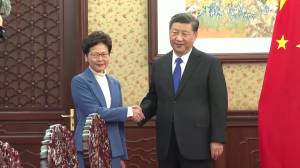 China's Xi vows support for Hong Kong leader during 'most difficult' time (01:01)