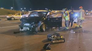 4 people hospitalized after set of wheels detach from transport truck on Hwy. 401
