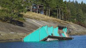 Derelict float home capsized off Valdes Island