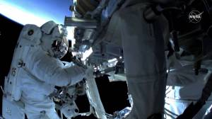 Spacewalking astronauts install solar panels outside ISS (02:58)