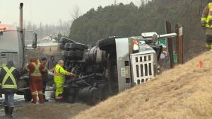 Transport carrying liquid asphalt rolls over on Palace road in Napanee