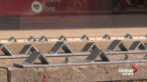 Metal barriers block sitting space on Jasper Avenue