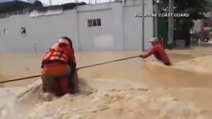 Emergency responders work to rescue people impacted by typhoon Vamco in Philippines (02:54)