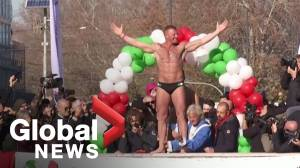 Italians dive into icy Tiber river to celebrate New Year's 2020 in Rome
