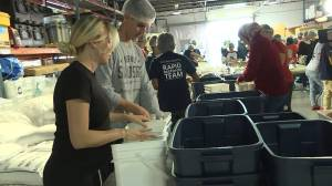 Canadian volunteers prepare food kits for the Bahamas
