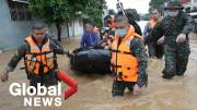 Play video: Typhoon Vamco: Rescuers evacuate trapped residents in flood-hit Philippines
