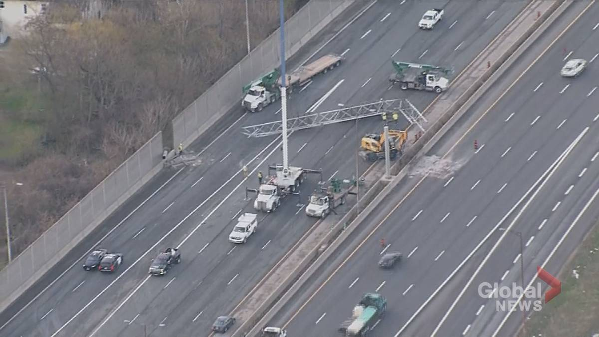 'Toronto antheral   dormant   aft  ample  motion   connected  QEW crushes vehicle'