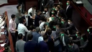 Politicians dragged away after brawl erupts in Hong Kong's legislature