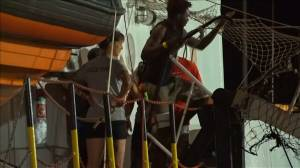 Migrants disembark in Italy after nearly 3 weeks at sea
