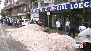 Powerful storm in Madrid area leaves mountains of hail in flooded market