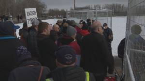 Crowd gathers outside GraceLife Church west of Edmonton Sunday to protest closure (02:09)