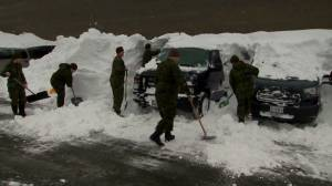 Canadian Forces help dig out vehicles stuck under snow after Newfoundland winter storm