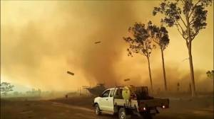 Fire tornado spins to life during bushfire in Queensland