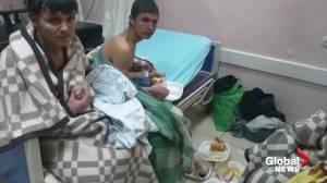 Rescued migrants treated in hospital after boat sinks in Turkey's Van Lake