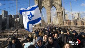 Thousands march across Brooklyn Bridge in show of solidarity with Jewish community