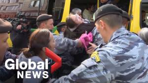 Kazakh police forcibly detain teenage girl during anti-China protests