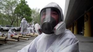 Coronavirus outbreak: Wuhan volunteers disinfect city as officials begin to ease lock down