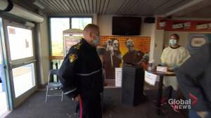 Police Chief Troy Cooper receives a COVID-19 vaccine in Saskatoon (00:37)