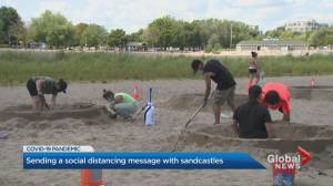 Coronavirus: Sand sculptures at Toronto beach illustrate socially distant summer safety