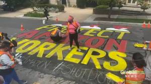 Activists paint mural outside Jeff Bezos's home demanding PPE for Amazon workers