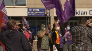 Unionized workers gather outside of the Ontario finance minister's office to protest the budget (02:01)