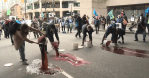 RAW VIDEO: Climate activists dump fake blood in front of B.C. Supreme Court in Vancouver