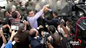 Venezuela's Guaido enters legislative palace after standoff with troops