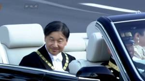 Japan's imperial couple rides through Tokyo to mark accession