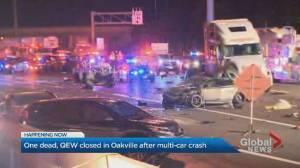 Woman dead, several injured in multi-car crash on QEW