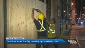 Toronto Hudson's Bay store boards up windows, removes coverings day later