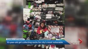 10-year-old girl warming the GTA one pair of socks at a time