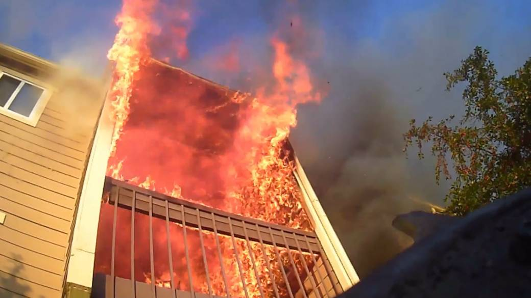 'Dramatic footage shows america  a firefighter's position  arsenic  they respond   to an flat  fire'
