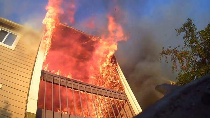 Click to play video: Dramatic footage shows us a firefighter's perspective as they respond to an apartment fire
